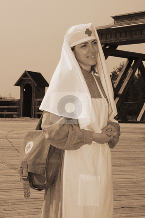 Retro styled picture with nurse stock photo, Old style picture with woman in nurse costume. Costume is authentic to the ones weared in time of  World War I. by Roberts Ratuts