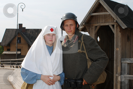 Retro styled picture with nurse and soldier stock photo, Old style picture with woman in nurse costume and man in soldier uniform. Costumes are authentic to the ones weared in time of  World War I. by Roberts Ratuts