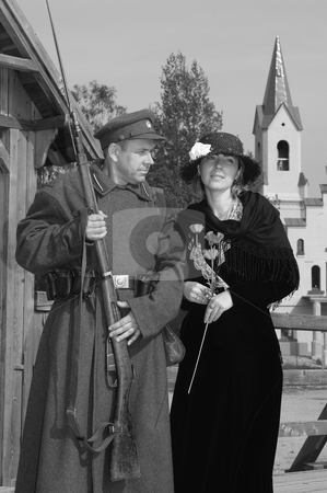 Retro style picture with woman and soldier stock photo, Old style picture with woman in dress and man in soldier uniform with weapon. Costumes are authentic to the ones weared in time of  World War I. by Roberts Ratuts