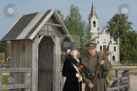 Retro style picture with woman and soldier stock photo, Old style picture with woman in black dress and man in soldier uniform with weapon. Costumes are authentic to the ones weared in time of  World War I. by Roberts Ratuts