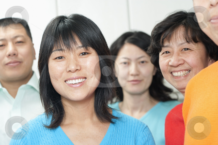 People Smiling stock photo, People smiling at camera.  Horizontally framed shot. by Paul Burns