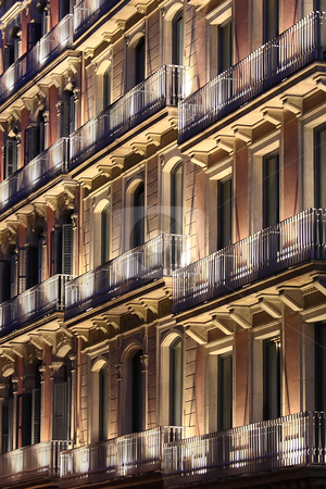 Beautiful illuminated building stock photo, A beautiful illuminated building at night in Barcelona by ARPAD RADOCZY