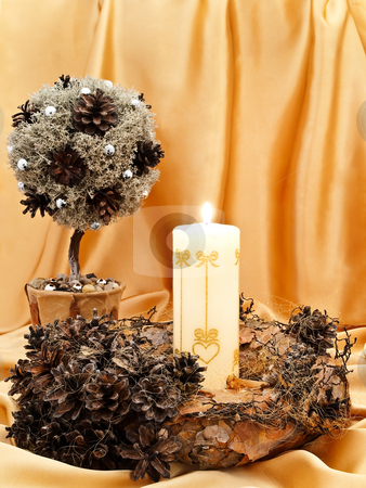 Decorative tree, wreath and candle stock photo, Handmade garland, decorative little tree with candle against golden textile background by Sergej Razvodovskij