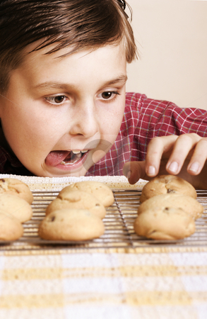 Succumb stock photo, Mmmmm, Just one, mum wont notice!