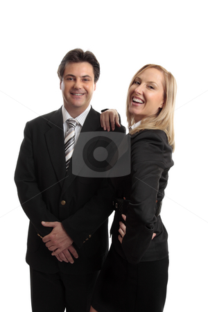 Successful business partners teamwork stock photo, Successful  business partners, sales team or office colleagues confidently smiling or celebrate success or goal.  Could also be husband wife team. by Leah-Anne Thompson
