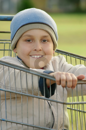 Boy in a Trolley stock photo, Boy in an old trolley shopping card by Leah-Anne Thompson
