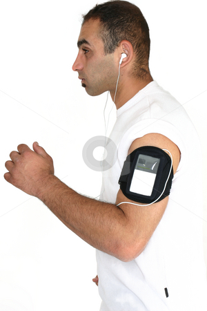 Music on the run stock photo, Health and Fitness.   A man jogs whilst listening to portable music by Leah-Anne Thompson