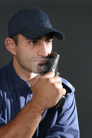 Security guard stock photo, Security officer in uniform - side lighting, space for text. by Leah-Anne Thompson