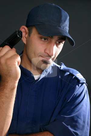 Security Guard stock photo, Security guard in blue uniform with gun. by Leah-Anne Thompson