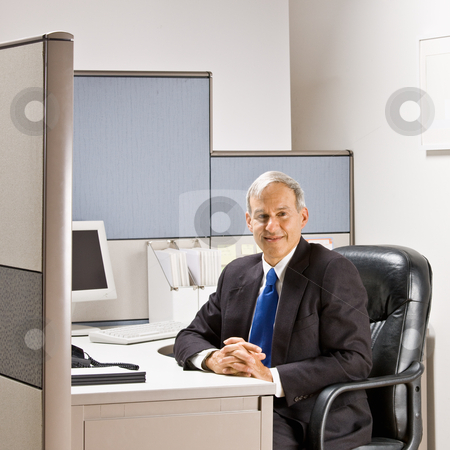 Businessman sitting at desk stock photo, Businessman sitting at desk by Jonathan Ross