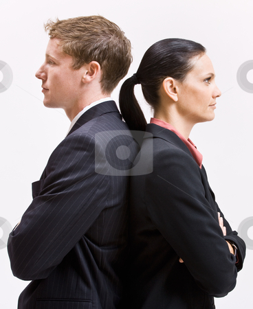 Business people standing back to back stock photo, Business people standing back to back by Jonathan Ross