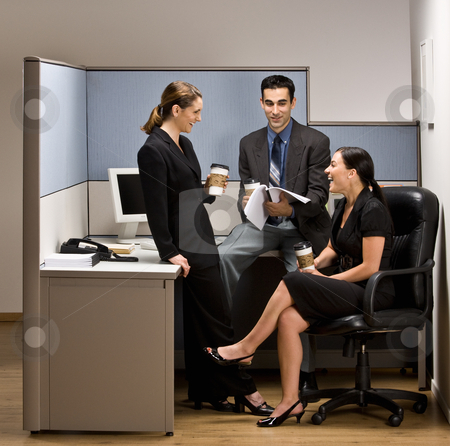Co-workers talking in office cubicle stock photo, Co-workers talking in office cubicle by Jonathan Ross