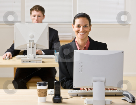 Business people typing on computers stock photo, Business people typing on computers by Jonathan Ross