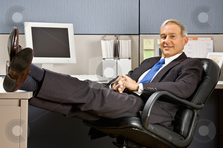 Businessman with feet up at desk stock photo, Businessman with feet up at desk by Jonathan Ross