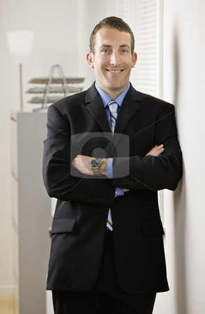 Businessman stock photo, Portrait of business man. Vertically framed shot. by Jonathan Ross
