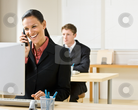 Businesswoman talking on telephone stock photo, Businesswoman talking on telephone by Jonathan Ross