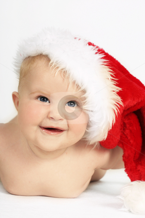 Santa Baby stock photo, Beautiful blue eyed baby in Santa Hat by Leah-Anne Thompson