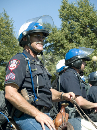Mounted Police stock photo, Police on horse back watch over protesters by Cora Reed