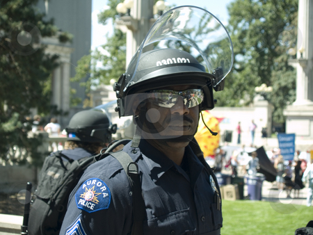 Police man stock photo, Police in riot gear watch over crowds by Cora Reed