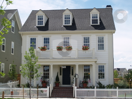 Colonial home stock photo, White house with dormers by Cora Reed