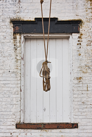 Rope and Door stock photo, Doorway of an old building with rope hanging in front of it by Stephen Bonk