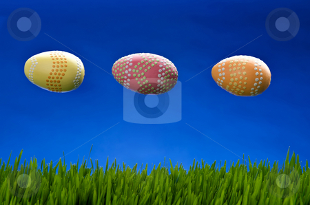 UFO Easter eggs in flight stock photo, Image of 3 easter eggs in flight above green grass and against a blue sky by Greg Blomberg