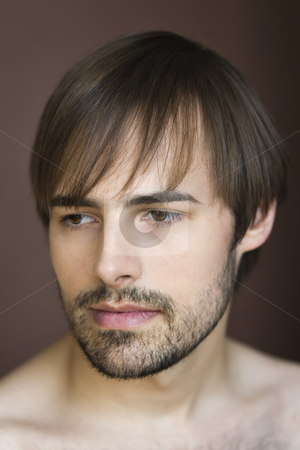 Young Man stock photo, Face shot of young man with no visible top.  Vertically framed shot. by Sean De Burca