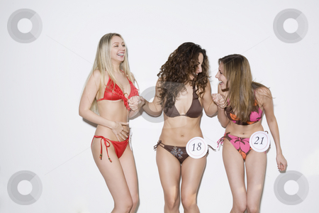 Young Women in Bikini Contest stock photo, Three young women participating in a bikini contest. Horizontally framed shot. by Sean De Burca