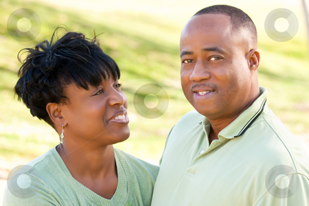 Attractive Happy African American Couple stock photo, Attractive Happy African American Couple Posing in the Park. by Andy Dean