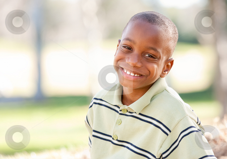 Happy Young African American Boy stock photo, Happy Young African American Boy in the Park. by Andy Dean