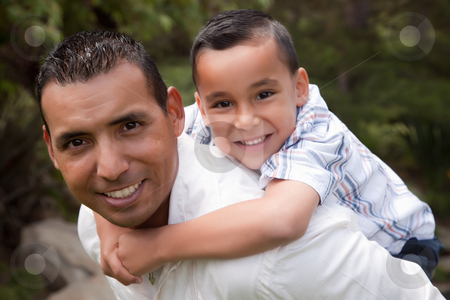 Hispanic Father and Son Having Fun in the Park stock photo, Hispanic Father and Son Having Fun Together in the Park by Andy Dean