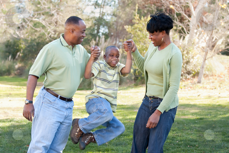 Playful African American Man, Woman and Child stock photo, Playful African American Man, Woman and Child Having Fun in the Park. by Andy Dean