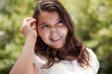 Cute Happy Hispanic Girl in the Park stock photo, Cute Happy Hispanic Girl Portrait in the Park. by Andy Dean