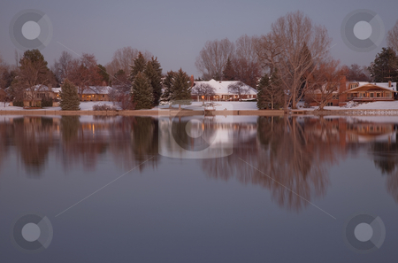 Luxury houses on a lake shore at dusk stock photo, Luxury houses with mature trees on a lake shore at dusk in winter scenery, Fort Collins, Colorado by Marek Uliasz