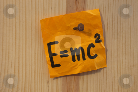 Einstein equation nailed stock photo, Albert Einstein well known physical formula describing equivalence of matter mass and energy, handwritten on bright orange reminder note nailed to wooden wall. by Marek Uliasz