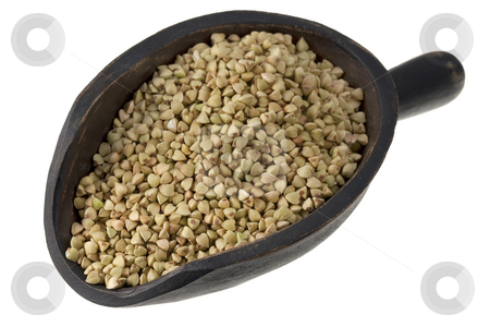 Scoop of buckwheat groats stock photo, Buckwheat groats on a rustic wooden scoop isolated on white by Marek Uliasz