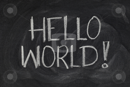 Hello, World! - message from the first computer program stock photo, Hello, World! message from a first computer program used in many introductory tutorials for teaching programming language, white chalk handwriting on blackboard by Marek Uliasz