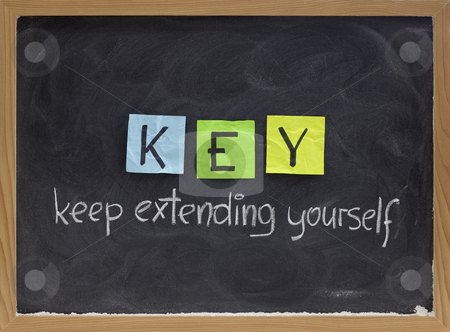 Keep extending yourself - motivation acronym stock photo, KEY (keep extending yourself) - coaching, motivational, self development acronym, white chalk handwriting and colorful sticky notes on blackboard by Marek Uliasz