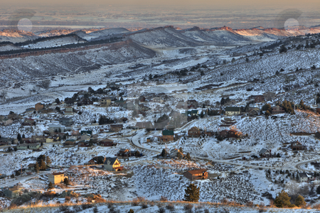 Mountain living at Colorado foothills stock photo, Mountain homes in northern Colorado near Fort Collins, view towards southeast from Horsetooth Mountain Park, plains with numerous lakes at background, winter sunset scenery by Marek Uliasz