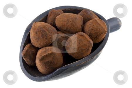 Scoop of chocolate truffles stock photo, Chocolate truffles on a rustic wooden scoop isolated on white by Marek Uliasz