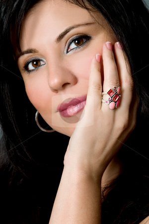 Attractive female face resting on hand stock photo, A woman resting her face gently on one hand and eyes gazing ahead. by Leah-Anne Thompson