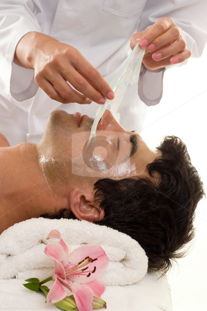 Facial Peel stock photo, Facial Peel - A beautician performs a facial peel on a male client. by Leah-Anne Thompson