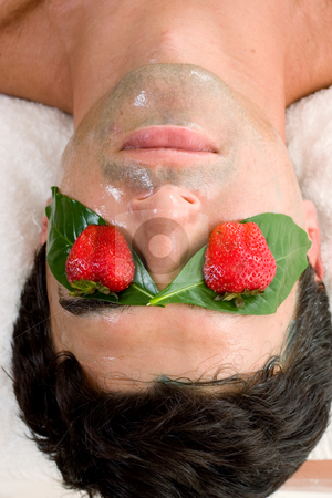 Fruit Acid Mask stock photo, A man enjoys a fruit acid peel by Leah-Anne Thompson