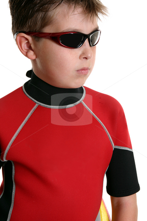 Boy in wetsuit and sunglasses stock photo, Surfer boy wearing a wetsuit and sunglasses. by Leah-Anne Thompson