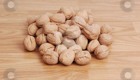 A pail of walnuts. stock photo, A big pail of hole walnuts on a wooden board. by Horst Petzold