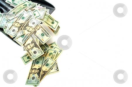 Shovel Money stock photo, Shoveling United States twenty dollar bills at the problem isolated on a white background by Lynn Bendickson