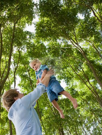 Father lifting son outdoors stock photo, Father lifting son outdoors by Jonathan Ross
