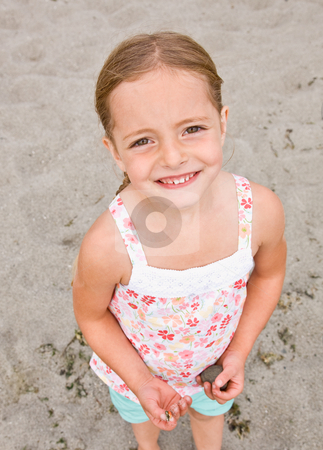 Girl holding rocks at beach stock photo, Girl holding rocks at beach by Jonathan Ross