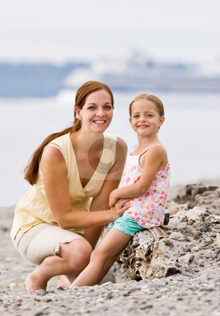 Mother and daughter on beach stock photo, Mother and daughter on beach by Jonathan Ross