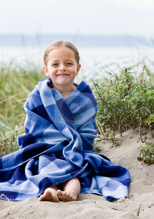 Girl wrapped in blanket at beach stock photo, Girl wrapped in blanket at beach by Jonathan Ross